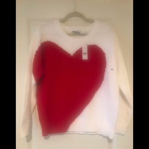 White sweater with red heart